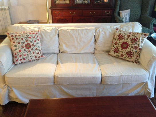 the couch with the slipcover and suzani from our favorite Uzbek artisan in Tashkent