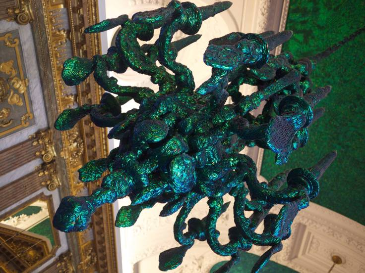 "Jan Fabre's 2002 installation, ""Heaven of Delight,"" uses the wing cases of 1.4 million Thai beetles"